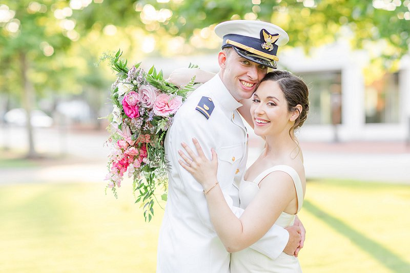 Sweet military groom and bride moment at their William and Mary wedding in Williamsburg Virginia