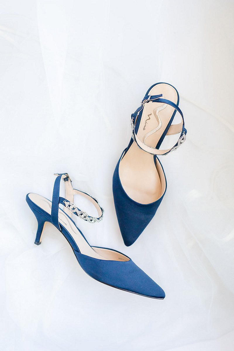 Pointed navy blue bridal shoes with bejeweled straps for Something Blue wedding idea