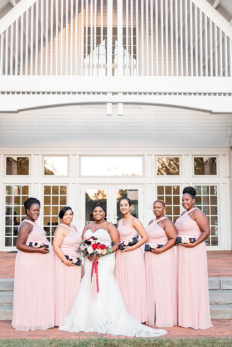 Beautiful bridesmaids in light pink dresses for fall wedding in Williamsburg Virginia