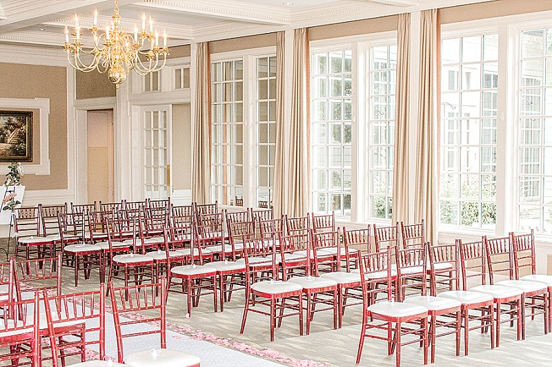 Classic ballroom wedding ceremony setup at Fords Colony Country Club in Williamsburg Virginia