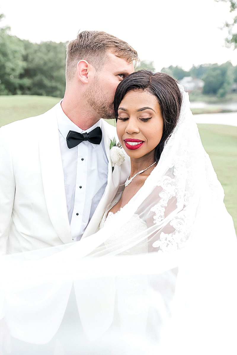 Beautiful black bride with bold red lipstick for a gorgeous classic bridal look