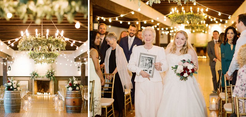 Bride being walked down the ceremony aisle by her grandmother with a memorial photo