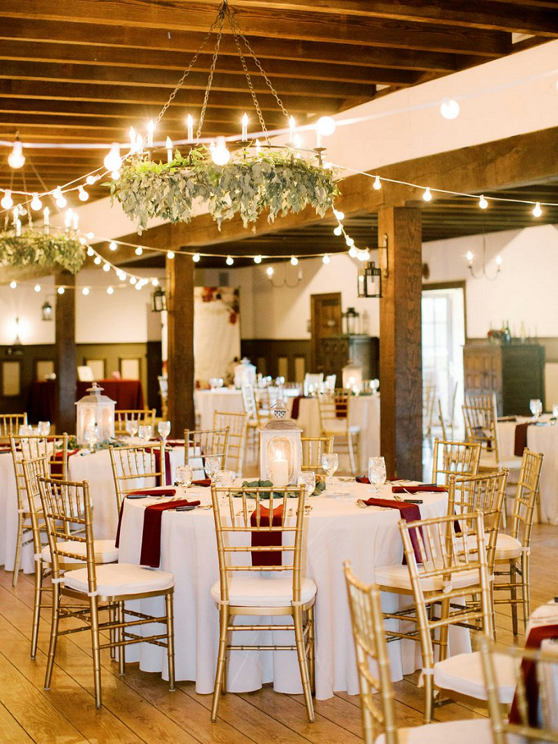 Rustic winery wedding decor ideas with gold chivari chairs and white lanterns for centerpieces