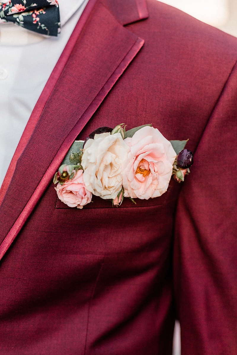 Gorgeous alternative boutonniere with pink wedding flowers for burgundy red suit pocket