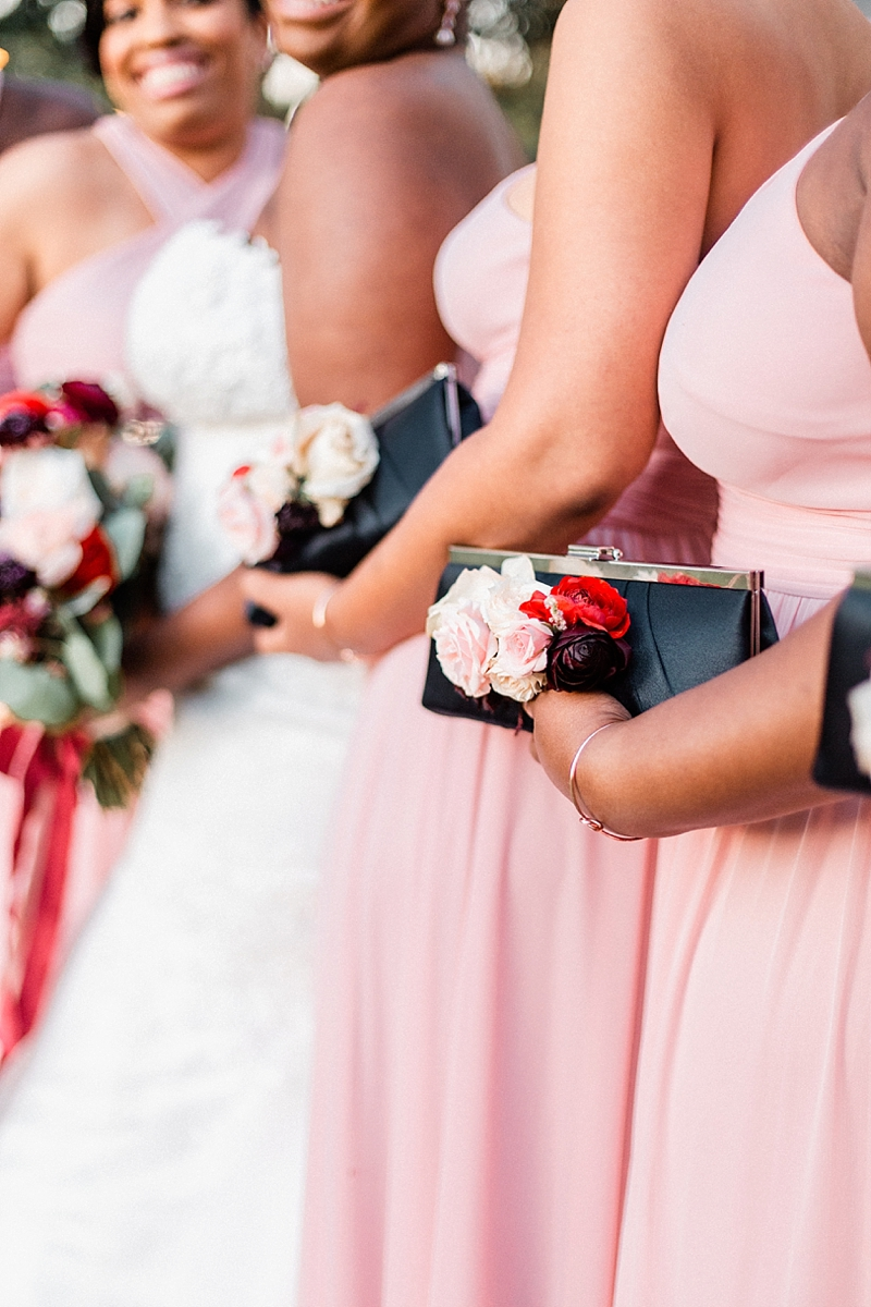 Alternative bridesmaid bouquet with wedding flowers on chic classic navy blue clutch purses