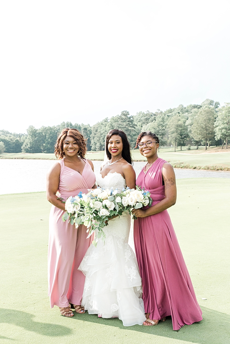 Beautiful wedding party dressed in pink bridesmaid dresses at Fords Colony Country Club in Williamsburg Virginia