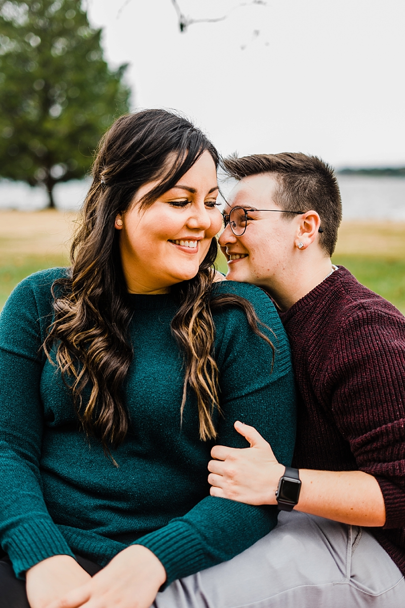 Romantic moment for two brides to be during their fall themed engagement proposal session