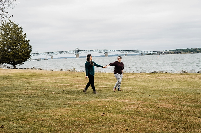 Romantic moment for two brides to be during their fall themed engagement proposal session in Yorktown Virginia